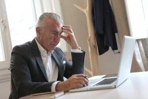 pexels-man-in-black-suit-jacket-while-using-laptop-3789100.jpg